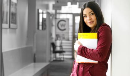A student standing in a hallway at CWC Jackson