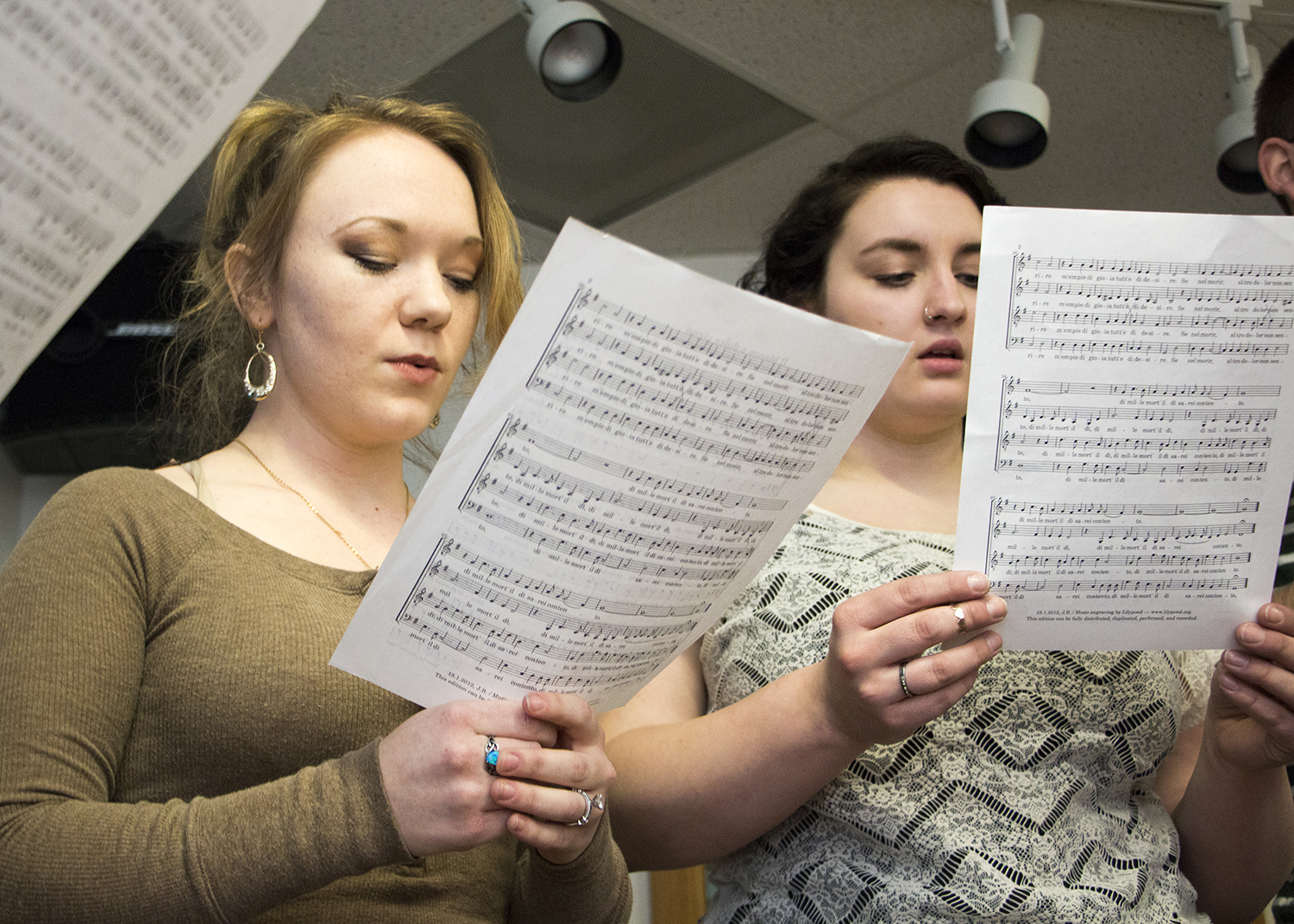 female students practice for choir