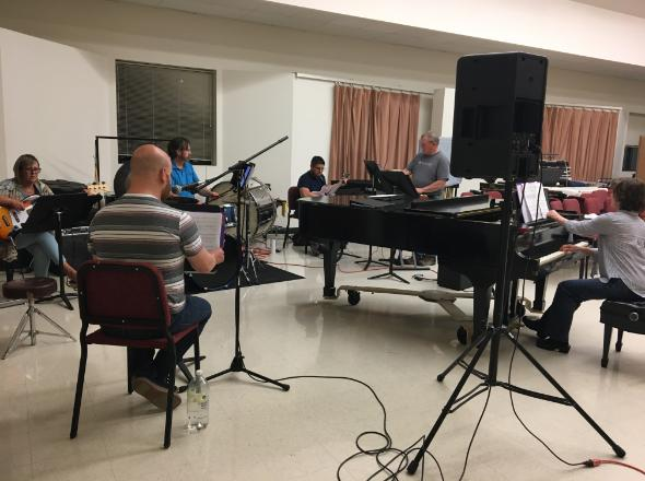 the orchestra of the retail song cycle sits in the music rehearsal room at CWC