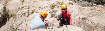 Two students rock climb in sinks canyon state park