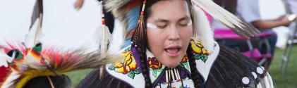 An American Indian sings native songs at welcome pow wow