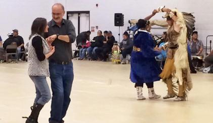 President Tyndall and his wife Audrey dance at the annual Powwow