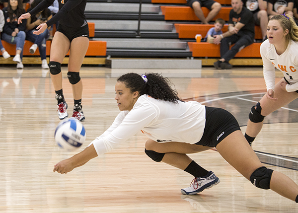 CWC volleyball player dives for the ball.