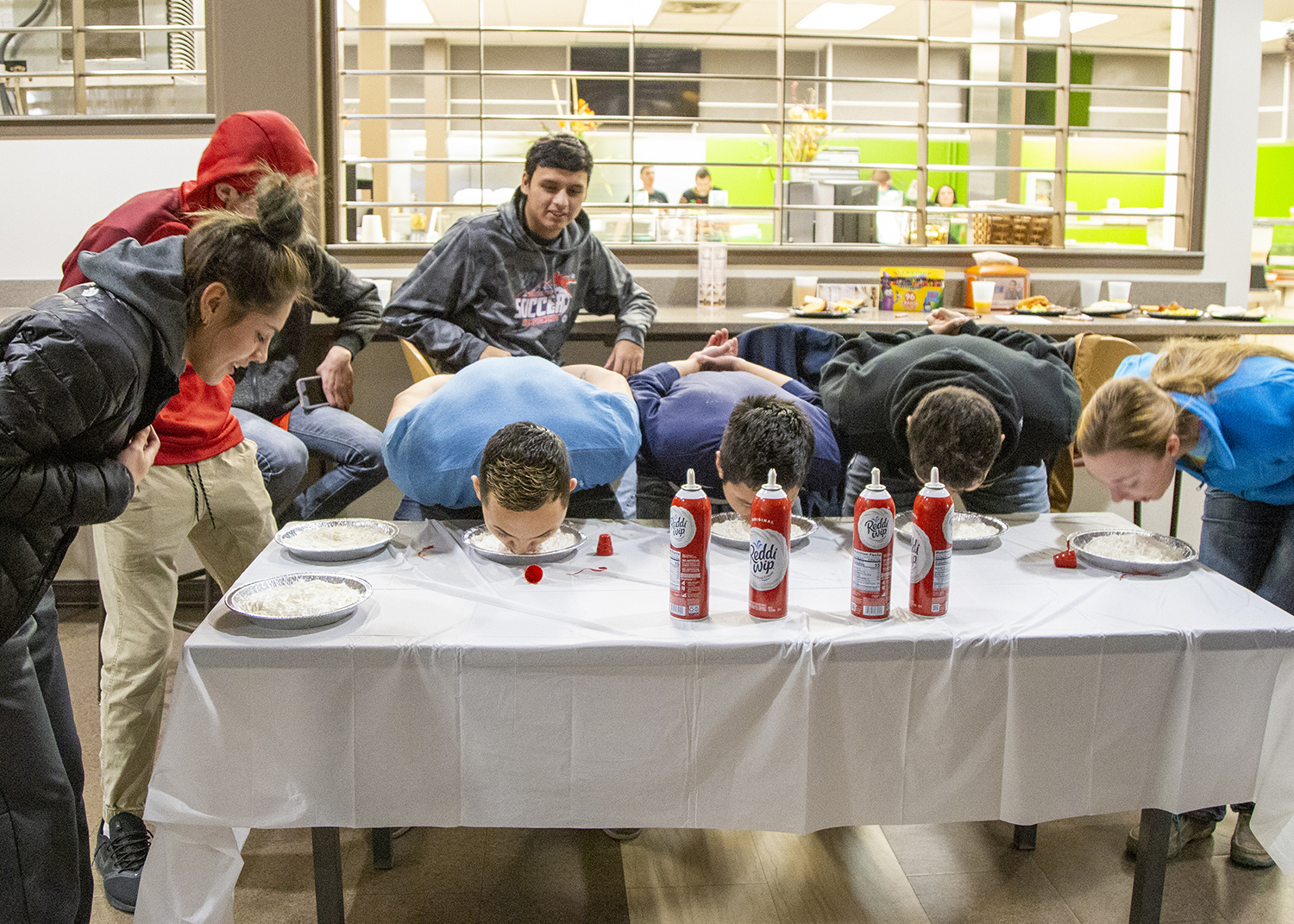 Students competing in a pie eating contest