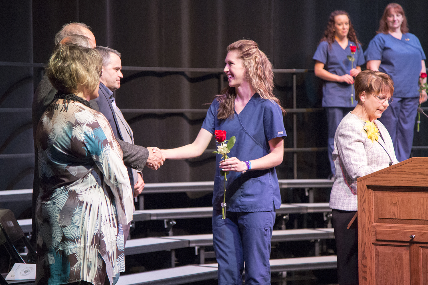 student nurse shaking hands with college vice president