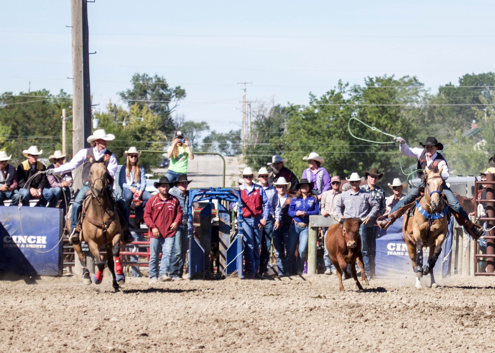 CWC rodeo Team ropers Brady Thurston and Bryce Sturman chase down a steer at the Chadron State College rodeo