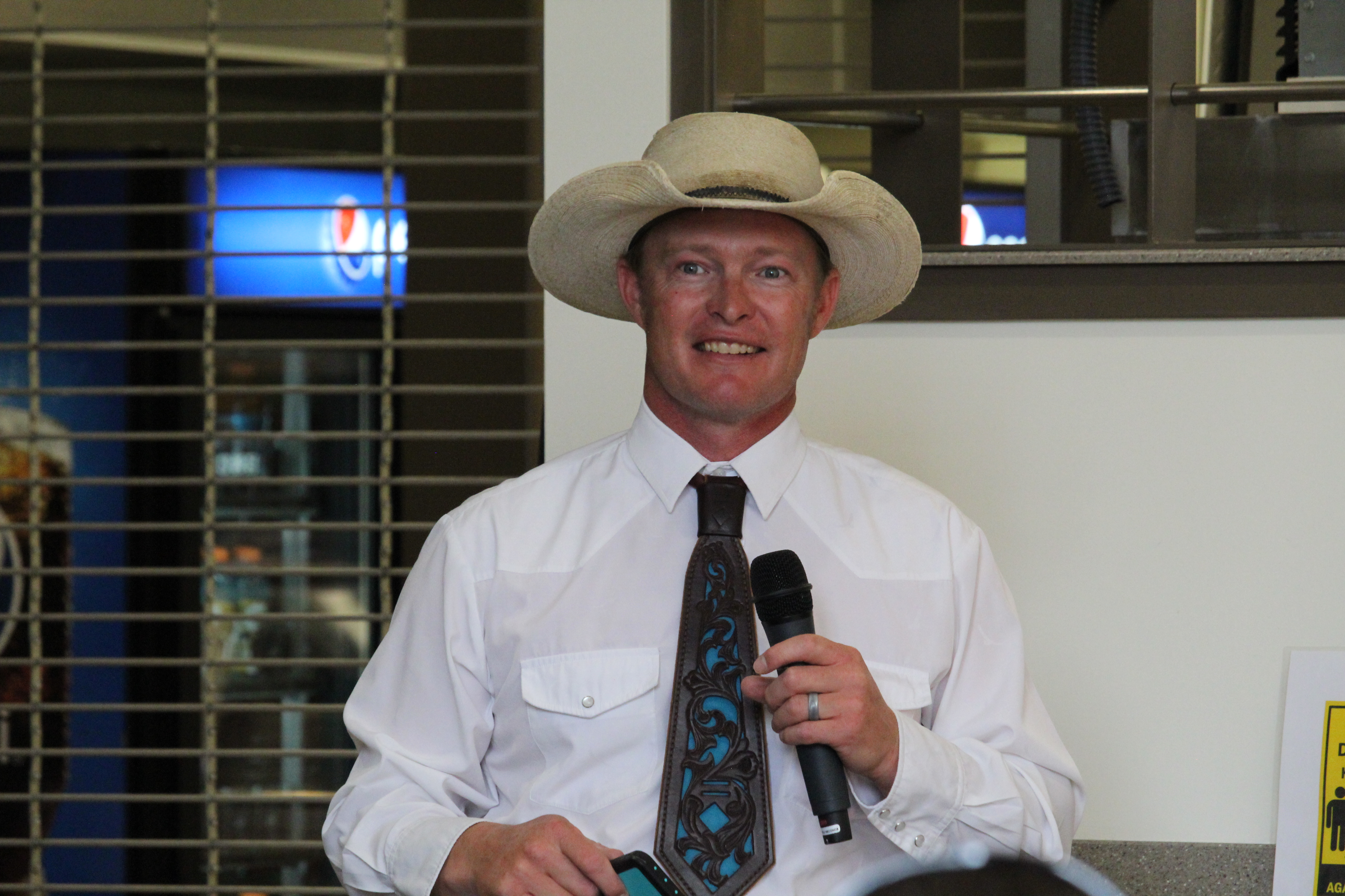 Tyler McCann announcing the Beef Roundup