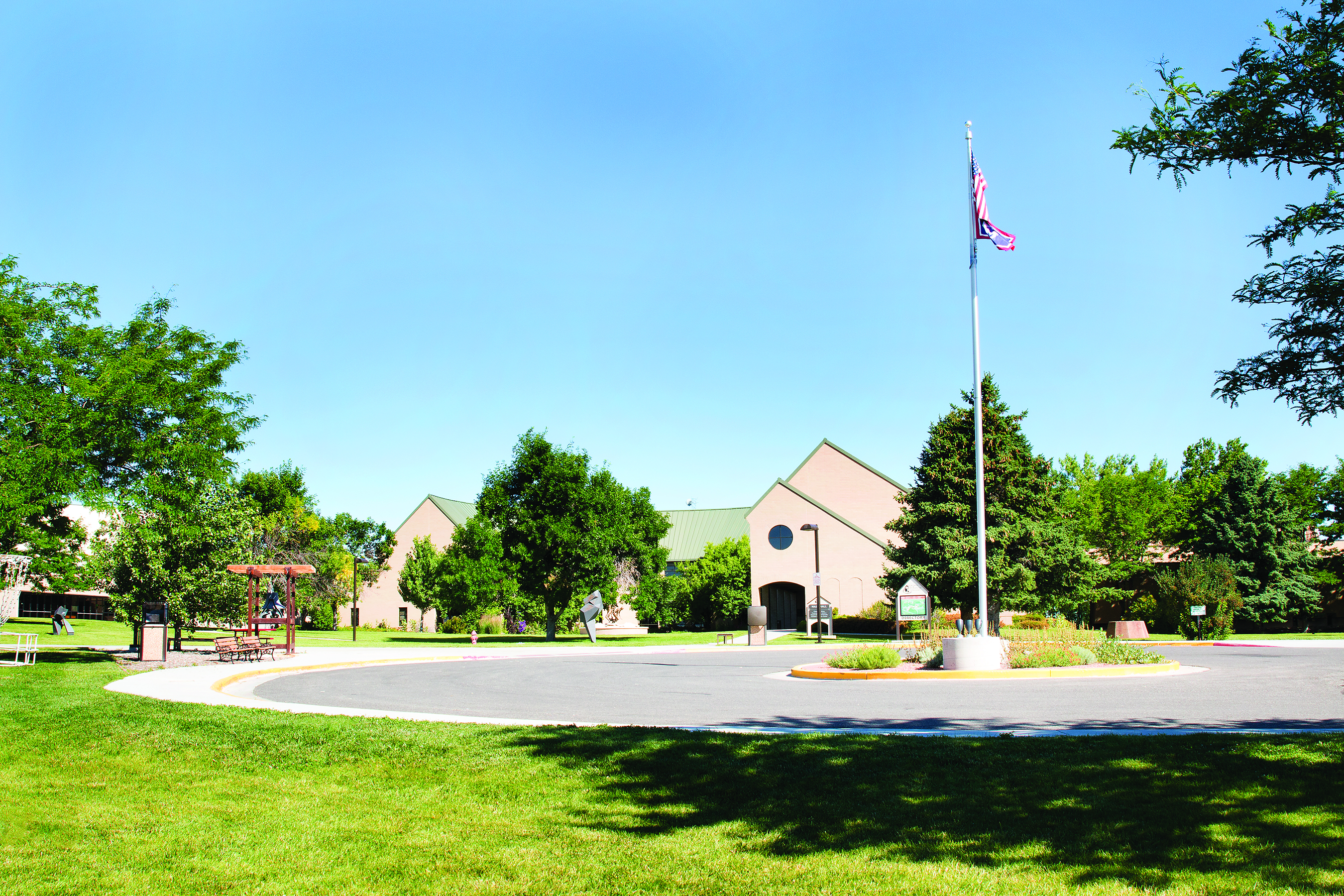 Main Building, flag pole, and trees at CWC