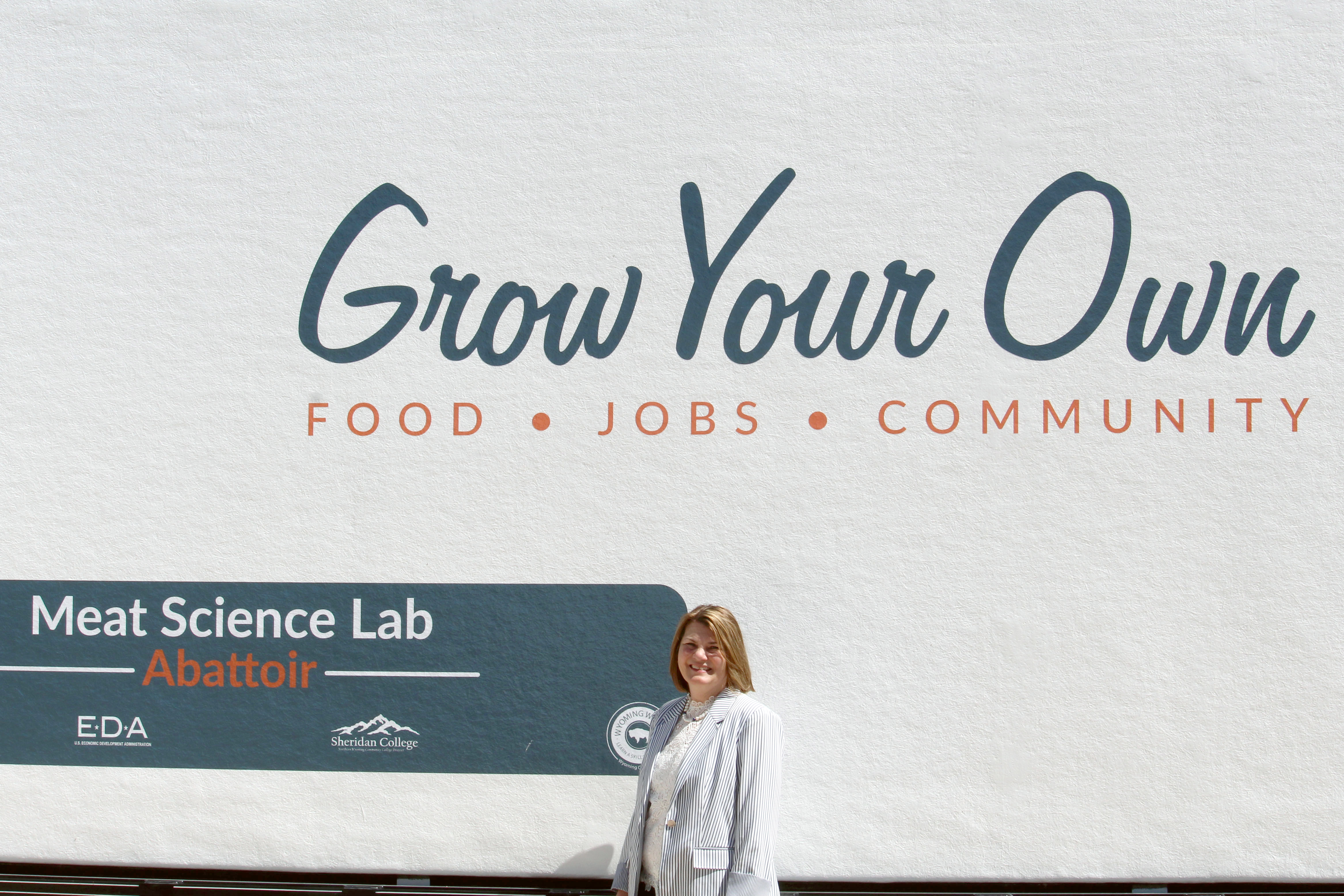 Jennie Gordon stands in front of CWC's mobile meat science lab