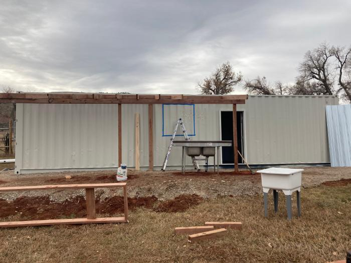 shipping container north side with washing station